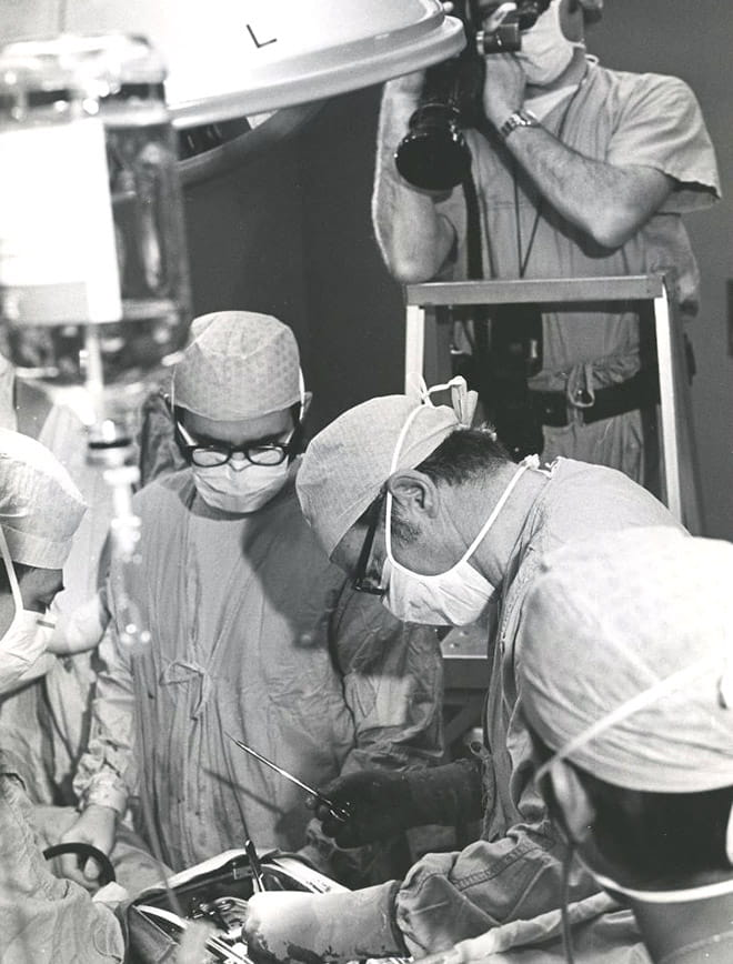 Jay Ankeney, MD, performing surgery circa 1972