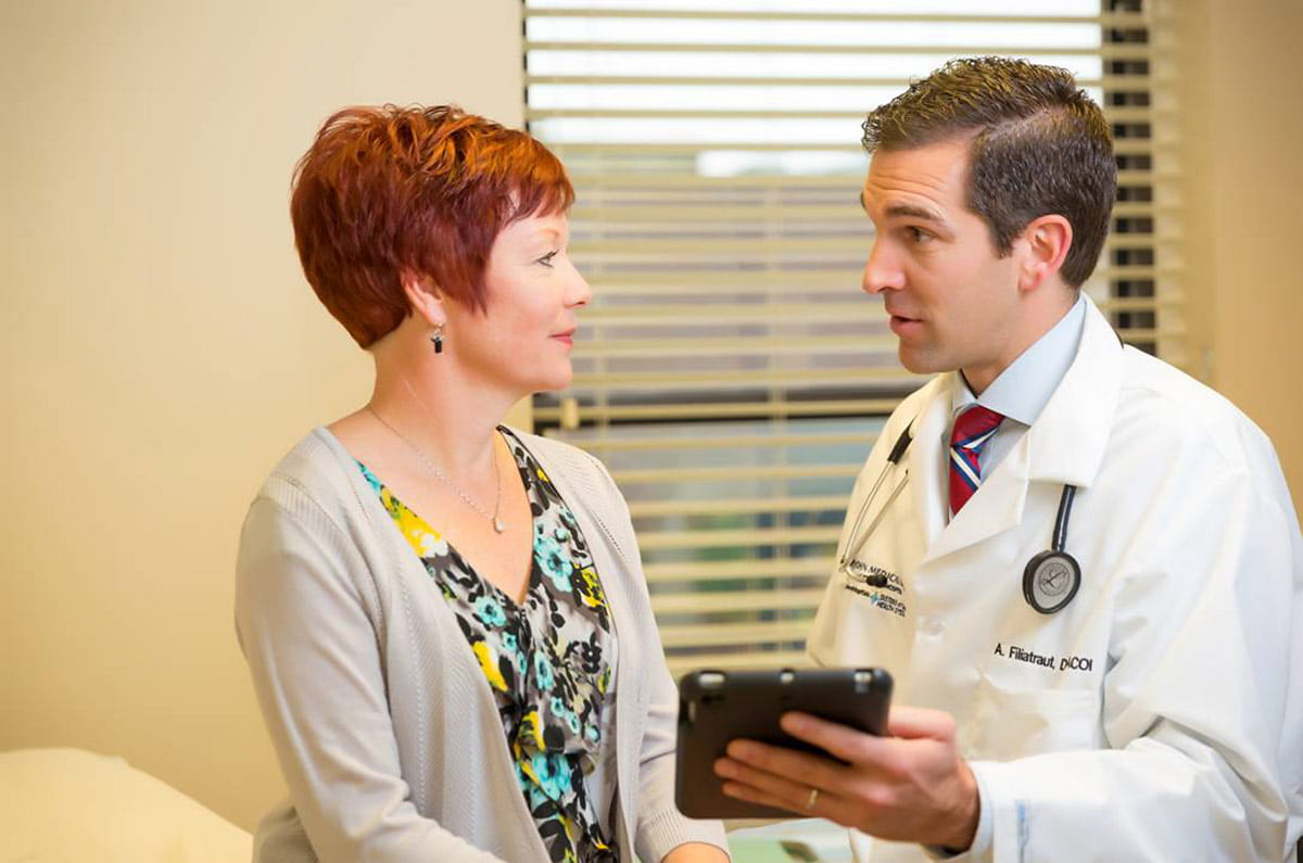 Patient confers with her primary care provider